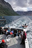 group of tourists on a boat at North Arm of Saglek Fjord, Torngat Mountains National Park, Newfoundland and Labrador, Canada