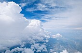 Above, Aerial, Air, Atmosphere, Atmospheric, Big, Blue, Cloud, Clouded, Clouds, Cloudscape, Cloudy, Congestus, Cumulonimbus, Cumulus, Flight, Flying, Formation, Front, Huge, Land, Landscape, Massive, Mid-air, Mood, Over, Overview, Phenomen, Side view, Sky