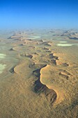 Above, Aerial, Africa, African, Arid, Aridity, Beauty, Blue, Climat, Desert, Desertic, Dunes, Empty, Extreme terrain, Heat, Landscape, Namib, Namibia, National park, Natural, Nature, Naukluft, Orange, Overview, Pattern, Sand, Sky, South, Sunny, Vertical,