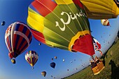 Wide view of hot air balloons take off. Mondial air balloon festival, largest one in Europe. Chambley, Lorraine, France. Europe