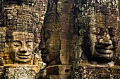 Cambodia, Angkor Thom, Bayon Massive stone faces watch your every move at Bayon, a well-known and richly decorated Khmer temple at Angkor in Cambodia