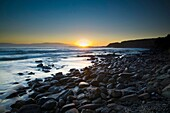 New Zealand, Southland, The Catlins Dawn looking towards the Brothers Point, viewed from Porpoise Bay