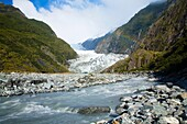 NEW ZEALAND, Westland, Westland National Park Glacial valley and river downstream of the Franz Josef Glacier