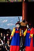 Actors in masks performing traditional Korean theatre