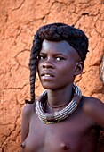 Himba girl, with the typical double plait hairstyle and necklace, Damaraland region, Namibia