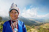 Akha hill tribe woman in Chiang Rai province, Thailand The Akha are the poorest of the hill tribes, well known to tourists for their extraordinary costumes and exotic appearance