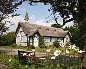 The thatched All Saints,  Church, Little Stretton Shropshire