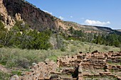 Main Loop trail showing the archeology features along Frijoles Canyon at Bandelier National Monument in New Mexico Tyuonyi Pueblo walls
