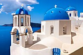Oia, Ia Santorini - Blue domed Byzantine Orthodax churches, Greek Cyclades islands.
