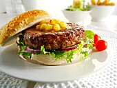 beef burger with sweetcorn relish and salad in a bun