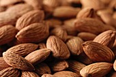 Shelled Almonds with their skins on in a pile