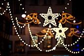 festive street Christmas lights with angel and stars