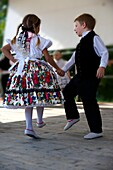 Young Svab children in traditional dress dancing at the wine harvest festival, Hajos Hajós Hungary