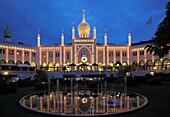 Denmark, Copenhagen, Tivoli amusement park at night