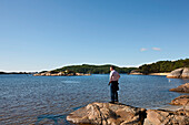 Elderly man looking out to sea, enjoying the sea air, tourist, landscape, coast at Mandal, Vest-Agder, South of Norway, Scandinavia, Europe