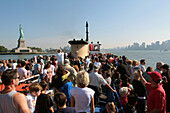 Tourists on a Boat From the Statue Cruises Line Going to the Statue of Liberty, Port of New York City, New York State, United States