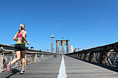 Jogger Crossing on the Footbridge of the Brooklyn Bridge, New York City, New York State, United States