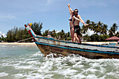 Vacationing Couple in a Boat, the Beach at the Coral Hotel, Bang Saphan, Prachuap Khiri Khan Province, Thailand, Asia