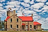 Rustic Lighthouse with a Flag at Half Mast, Mackinac Island, Michigan, US