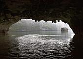 Chinese Junk Seen Through a Cave Entrance, Halong Bay, Quang Ninh, Vietnam