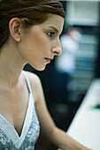 Young woman looking away, profile