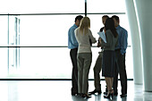 Business associates standing together in meeting