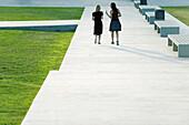 Friends walking together in conversation