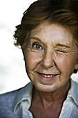 Senior woman winking, portrait