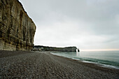 France, Normandy, Etretat, cliff and rocky beach