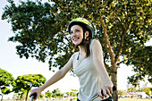 Teen girl riding bicycle, portrait