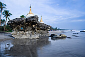 Two pagodas on top of rocks at Ngwe Saung Beach, Myanmar