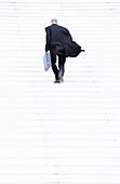 Businessman walking up steps, motion, full frame