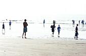 People on beach, blurred