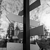 Wooden Arrow Signs on a Post