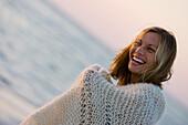 Woman in Blanket Smiling