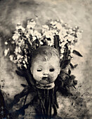 Antique Doll Head With Flowers