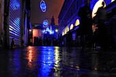 Neon lights in the street at night, New Year's Eve, near the Rialto Bridge, Venice, Italy