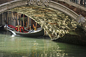 Empty gondola, bridge, Venice, Italy