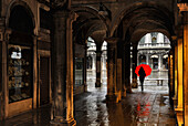One woman with red umbrella, connecting passage to Piazza San Marco, Venice, Italy
