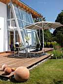 Modern private house with terrace, pond and garden furniture, near Bad Aibling, Bavaria, Germany