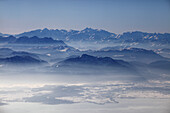 Aerial photo of northern Chiemsee in winter, view south towards the Chiemgau and Austrian Alps, Bavaria, Germany