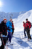 Group of people backcountry skiing with ski tracks in the background, Kreuzspitze, Villgraten range, Hohe Tauern range, East Tyrol, Austria, Europe