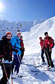 Group of people backcountry skiing with ski tracks in the background, Kreuzspitze, Villgraten range, Hohe Tauern range, East Tyrol, Austria, Europe