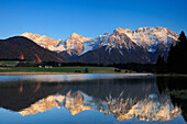 Snow-covered Karwendel range reflecting in a mountain lake, Kruen, Werdenfelser Land, Bavarian Alps, Upper Bavaria, Bavaria, Germany