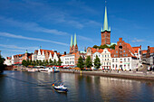 View over the Trave river to the old town of Luebeck with St Mary´s church and church of St Petri, Hanseatic city of Luebeck, Baltic Sea, Schleswig-Holstein, Germany
