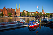Old storehouses at Holsten harbour, St Mary´s church and church of St Petri, Hanseatic city of Luebeck, Baltic Sea, Schleswig-Holstein, Germany