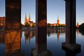 View over harbor to old town with St. Mary's church and church of St Peter, Hanseatic City of Luebeck, Schleswig Holstein, Germany