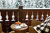 Breakfast on a terrace in winter, chalet