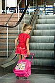 Little girl on escalator