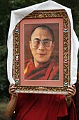 France, Paris, Buddhist holding a picture of the Dalaï Lama